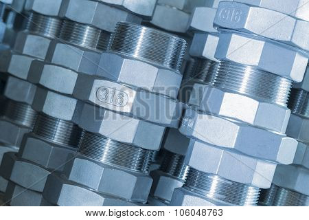 Metal threaded connection parts closeup, technical blue
