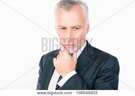 Old Intelligent Businessman  Ponders Putting His Hand On Chin