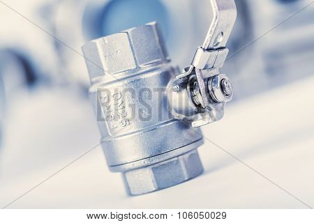 ball valve with internal and external thread on a light background