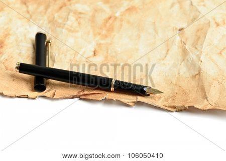 Elegance golden ink fountain pen on grunge old paper