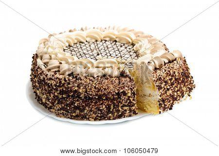 Chocolate cream cake on white background with slice