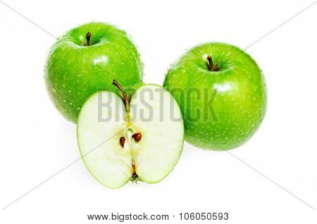 Green apples whole and half isolated on white background