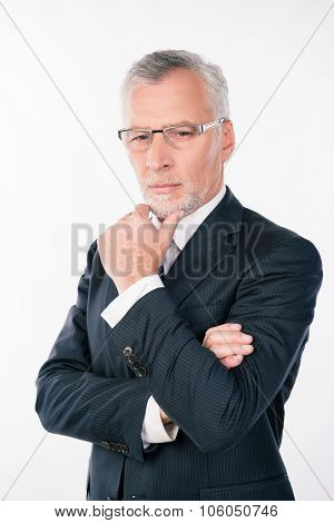 Old Intelligent Businessman With Glasses Ponders Putting His Hand On Chin