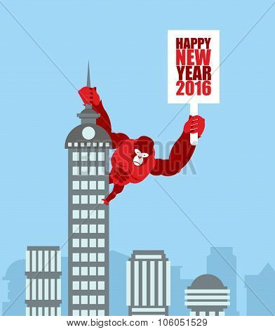Monkey On Skyscraper. King Kong Holds A Sign With New Year. Huge Strong Gorilla Climbed Up On Munici
