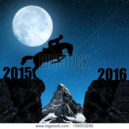 The rider on the horse jumping into the New Year 2016. In the background Matterhorn.