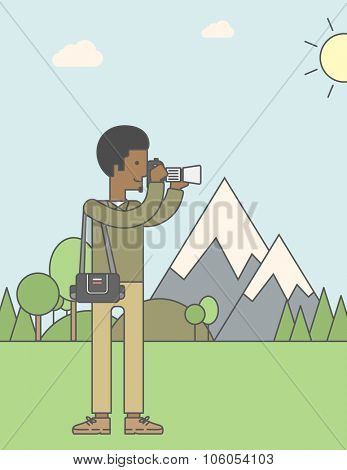An asian photographer taking photo in mountains. Vector line design illustration. Vertical layout with a text space for a social media post.