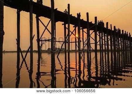MYANMAR - MARCH 3: Silhouetted people on U Bein Bridge at sunset Amarapura Mandalay region MARCH 3, 2015, Myanmar Burma