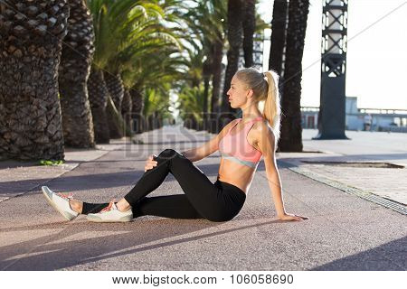 sportswoman  doing fitness exercise outside in palm park