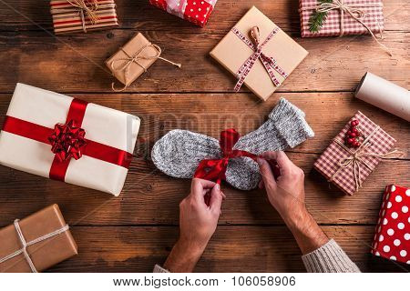 Man holding Christmas presents