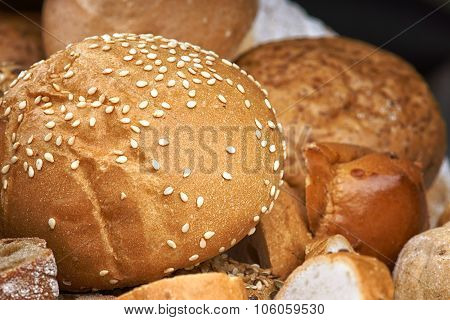 Baked bread bun with sesame seeds