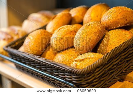 Bread And Buns On Shelf In Bakery Or Baker's Shop