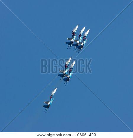 Group Su-27 Performing Aerobatics At An Airshow