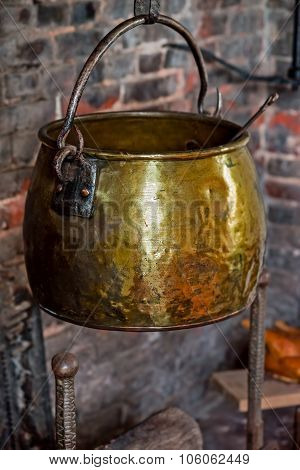 Single Antique vintage 1590 cauldron hand forged cooking pot hangged by the hearth fireplace old gol