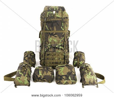 Military backpack with accessories isolated on white. Big size. Front view.