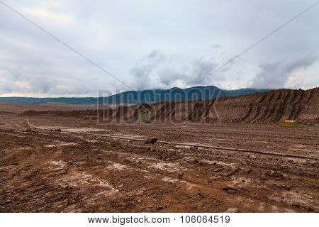 Abandoned mine - damaged landscape after ore mining.
