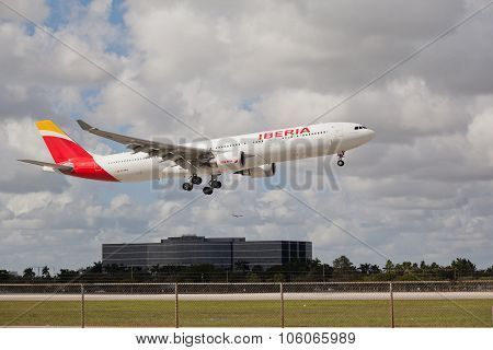 MIAMI, USA - November 1, 2015: An Iberia Airbus 330-300 landing at Miami International Airport. Iber