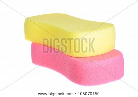Red And Yellow Bathing Sponge Over White Background