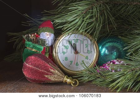 New Year's Toys Since Hour Under Green Fir Tree On Dark Background