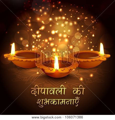 Creative illuminated oil lit lamps with Hindi wishing text Deepawali Ki Shubhkamnaye (Best Wishes of Deepawali) on floral decorated shiny brown background.