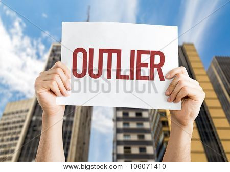 Outlier placard with urban background