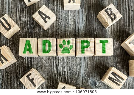 Wooden Blocks with the text: Adopt