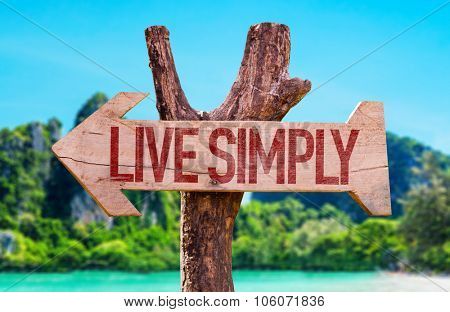 Live Simply arrow with beach background