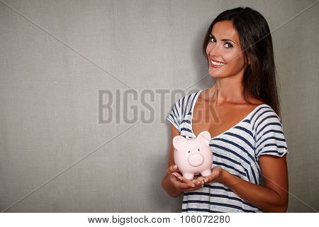 Charismatic Lady Holding Moneybox While Smiling