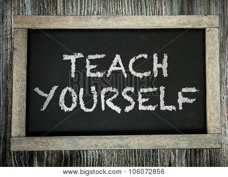 Teach Yourself written on chalkboard