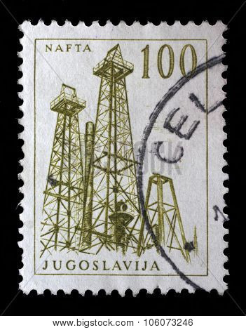 YUGOSLAVIA - CIRCA 1958: Stamp printed in Yugoslavia shows a Oil derricks, Nafta, with the same inscription, from series