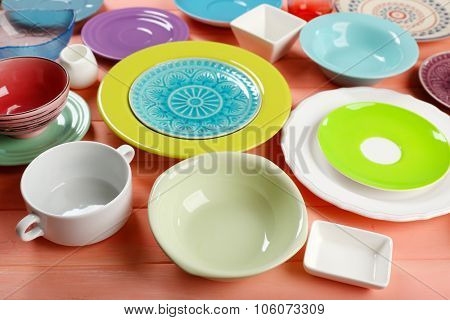 Different tableware on wooden table close up