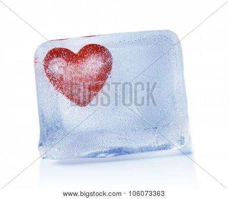 Red heart in ice cube on gray background