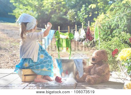 Barefoot Girl Washing Her Toys Clothes Near Washtub