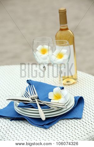 Table setting with Wine bottle and glass