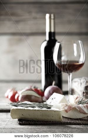 Still life with various types of Italian food and wine,  black and white retro stylization
