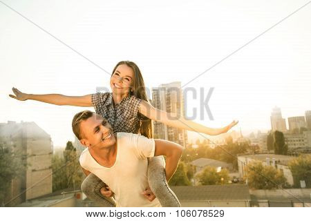 Girl and boy are outdoors at roof