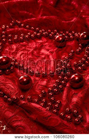 Christmas Garland Made From Small Red Beads.on A Red Background. New Year Toy.