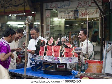 Watermelon Vendors At The Bazar