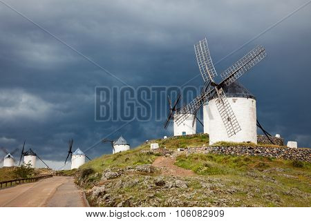 Old Spanish windmills on dramatic sky and rainy weather, Campo de Criptana, Castilla la Mancha province, Spain, Europe