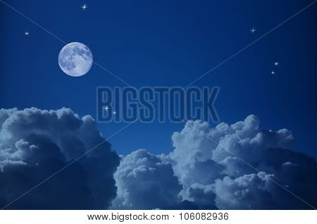 Fantastic view of Night Sky - Clouds, Stars and the Moon, background with copy space