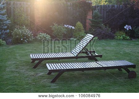 Chaise Lounges At Sunset