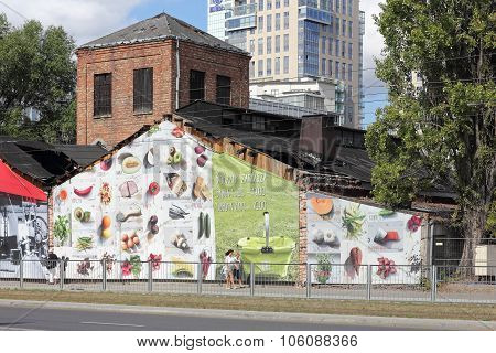 Advertising For Food At An Old Factory In Warsaw