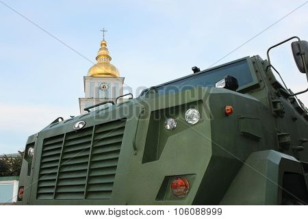 Military Vehicle Close-up Against The Church Bell Tower