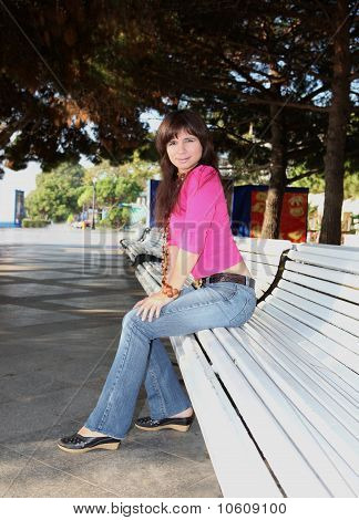 Young Girl Sitting On Bench