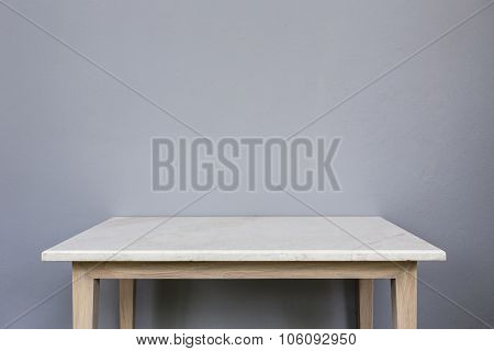 Empty Top Of White Mable Stone Table On Grey Wall Background