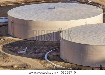 round metal water tanks at filtration plant - industrial architecture abstract