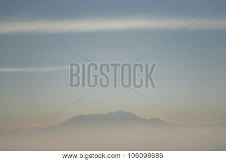 Foggy and volcano mountain during sunrise taken from Pinajagun II view point ,Indonesia.