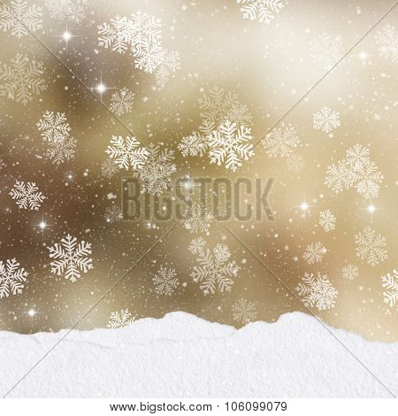Mounds of snow on a gold Christmas background with stack of presents
