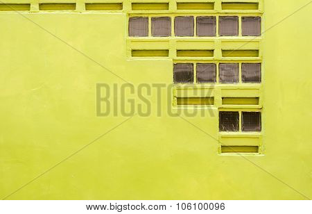 Concrete Wall Dark Yellow Color With Blowhole For Texture Background