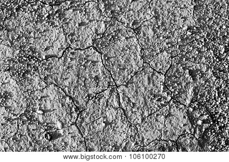 Surface Of A Grungy Dry Cracking Parched Earth For Textural Background. Black And White Process