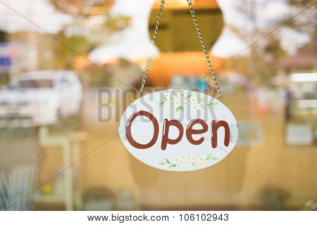 Open Sign Broad Hanging On Mirror Door At Coffee Shop Cafe